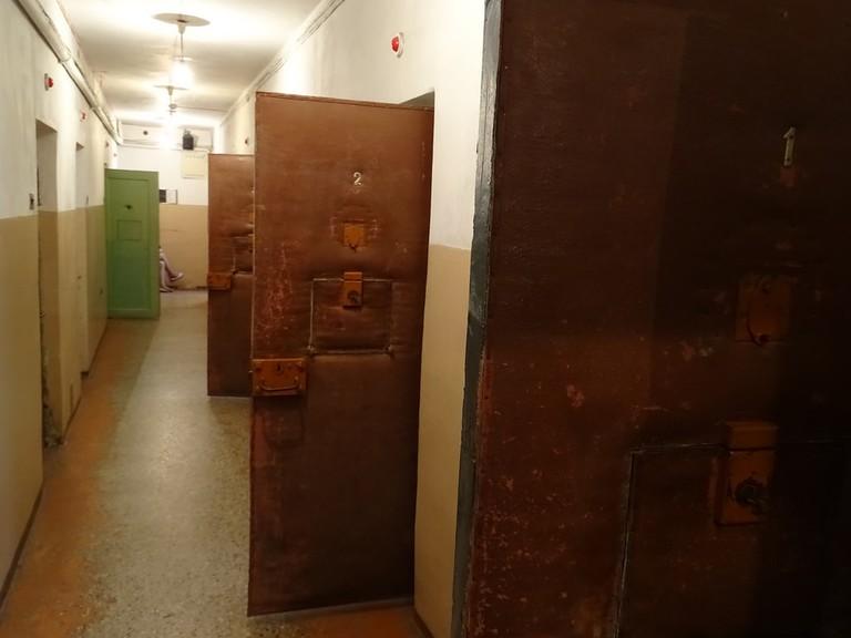 A corridor in the basement of the Museum of Genocide Victims, showing the open doors of prison cells | © Adam Jones / Flickr