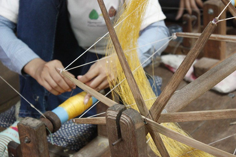 Golden silk is hand woven on a loom at Koh Dach   ©Marissa Carruthers