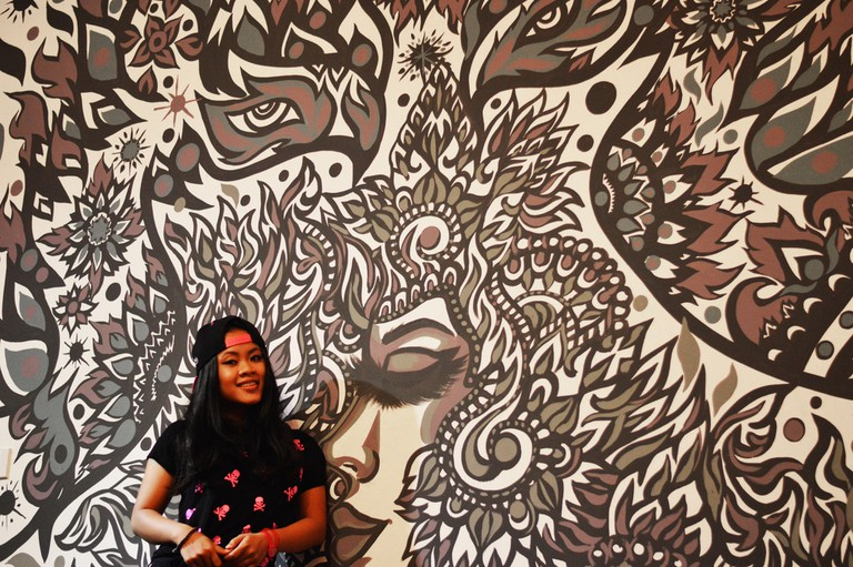Lisa Mam with a piece of her and Peap Tarr's work © Peap Tarr