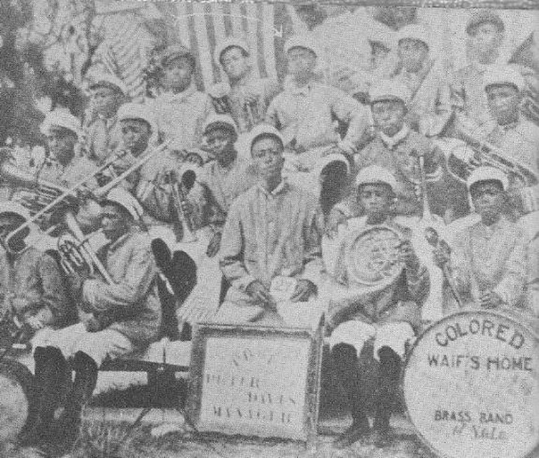 """The arrow at the top of this photo points to Louis Armstrong at the age of 11, a member of the """"Colored Waifs Home"""" band/NationalArchieves"""