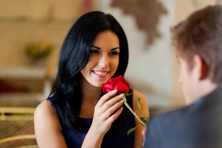 A man gives a woman a rose in a restaurant, blurgh!