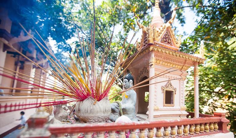 Offerings are left at spirit houses during Khmer New Year © Tepikina Nastya/Shutterstock.com