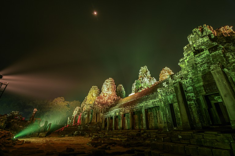 Bayon Temple is lit up at night as part of Khmer New Year Celebrations © Elite Studios/ Shutterstock.com