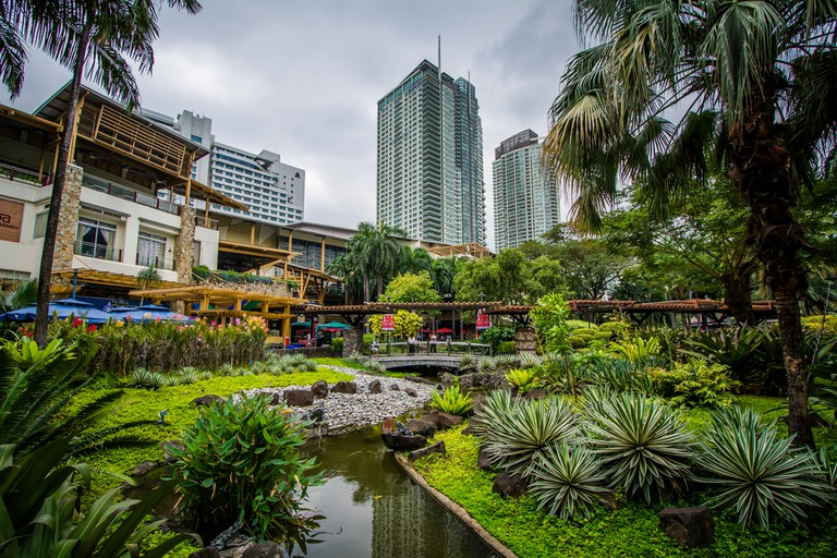 Gardens and skyscrapers at Greenbelt Park, in Ayala, Makati
