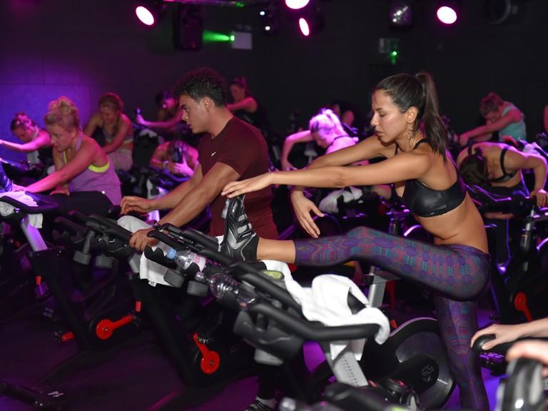 Spinning class goers stretch their legs