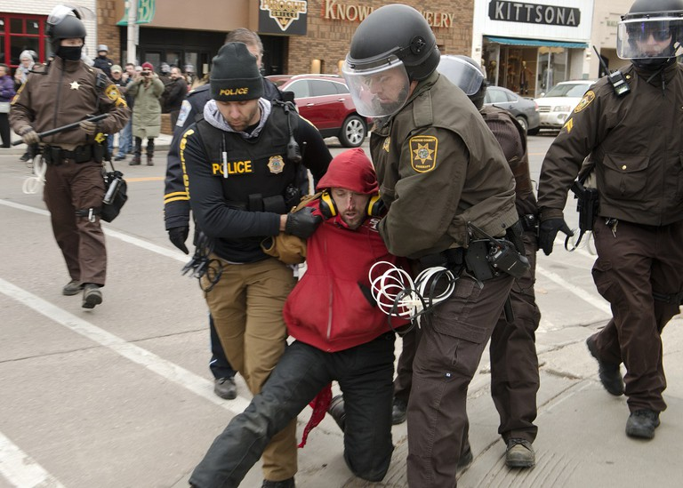 A protester at Standing Rock being arrested by police.