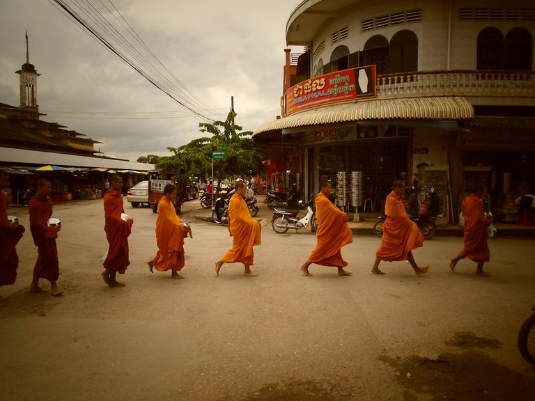 Monks on their morning collection of offerings in Battambang, Cambodia | © Marissa Carruthers