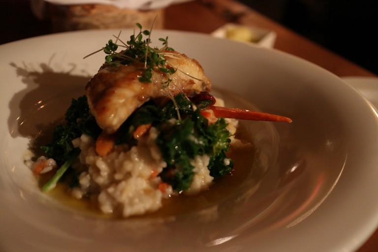 Dinner served at Bison Restaurant | © Elsie Hui / Flickr