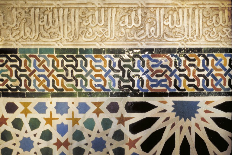 Intricate tile mosaics adorn the interior walls of the Alhambra´s Nasrid palaces, MCAD Library, flickr