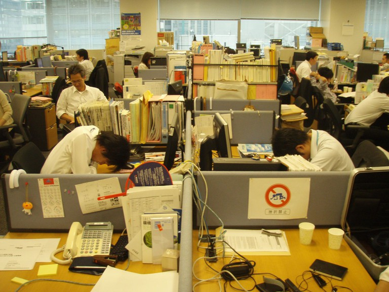 Overworked Workers sleep in their office | ©Hiroo Yamagata / Flickr