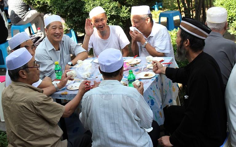 Hui Men Enjoy a Meal Together in Xi'an, Shaanxi | ©Nagarjun Kandukuru/Flickr