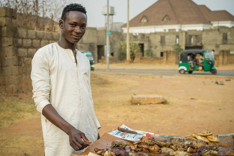 A suya seller in Nigeria