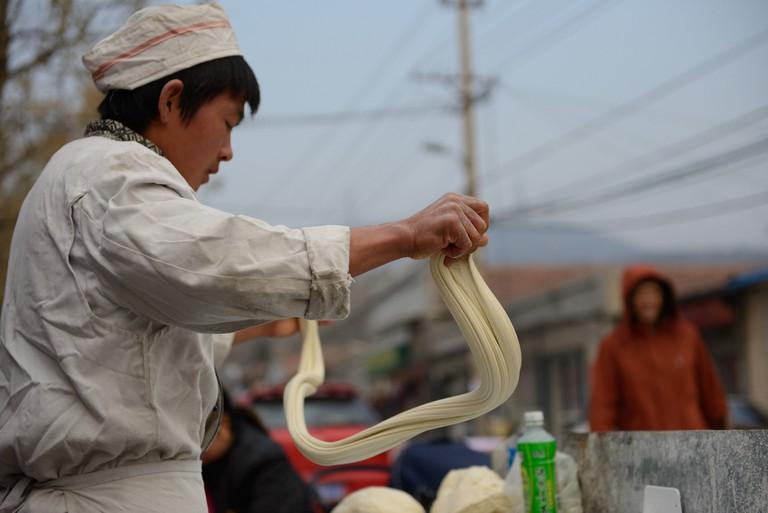 A Young Hui Man Hand Pulls Noodles | ©michael davis-burchat/Flickr