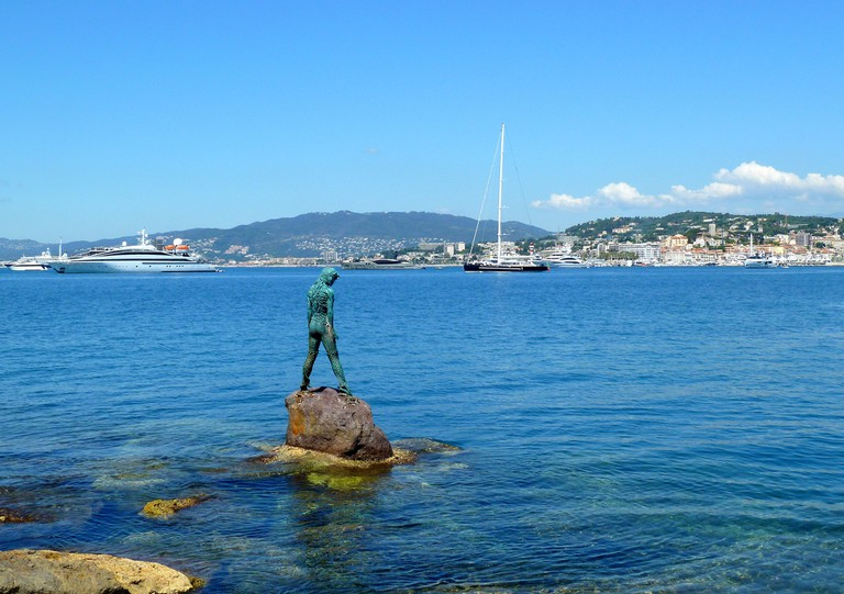 The mermaid Atlanta stands ready at the port Pierre Canto to defend and protect her