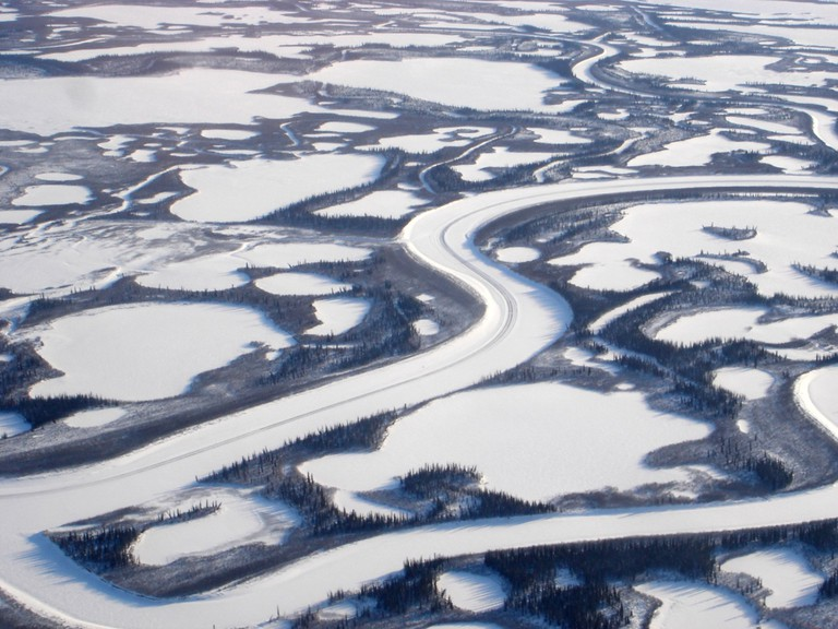 Aerial view of Canada's longest river, the Mackenzie River, empties into the Beaufort Sea | © Max Lindenthaler/Shutterstock