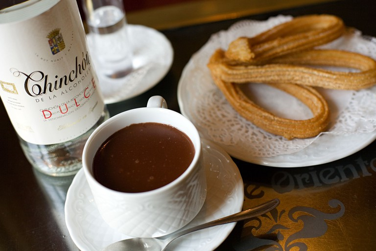 Some chocolate and churros| © Madrid Destino Cultura Turismo y Negocio