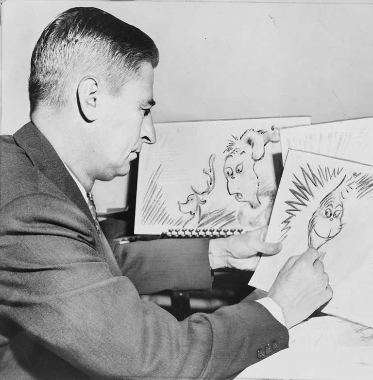 Dr. Seuss – American writer and cartoonist, at work on a drawing of the Grinch for How the Grinch Stole Christmas | © Library of Congress, New York World-Telegram & Sun Collection / WikiCommons