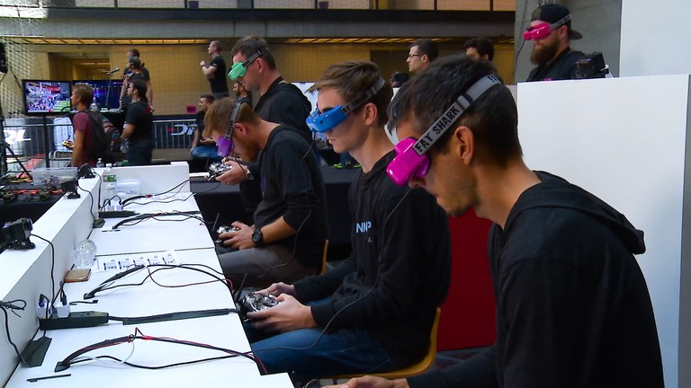 Drone Racing League pilots wear headsets to fly their drones via first-person view