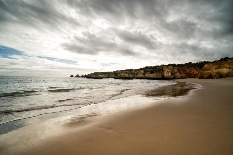 Beach and cliffs at Praia do Vau in the Algarve Portugal