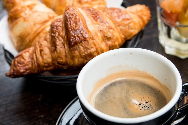 Coffee and croissant, typical Portuguese breakfast| © ilolab/Shutterstock