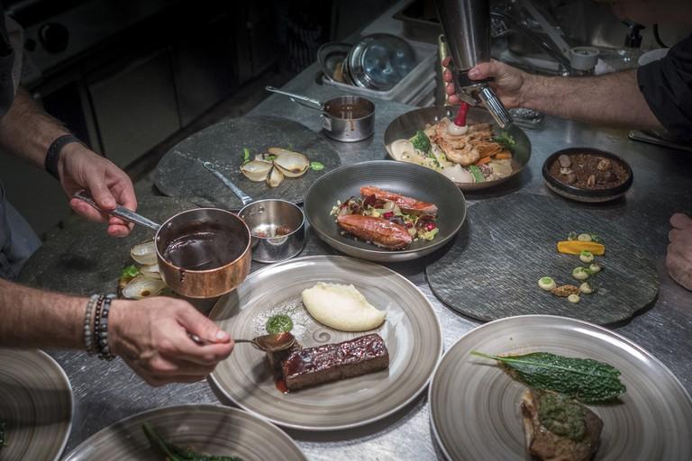Chefs hard at work at Tel Aviv's Kitchen Market