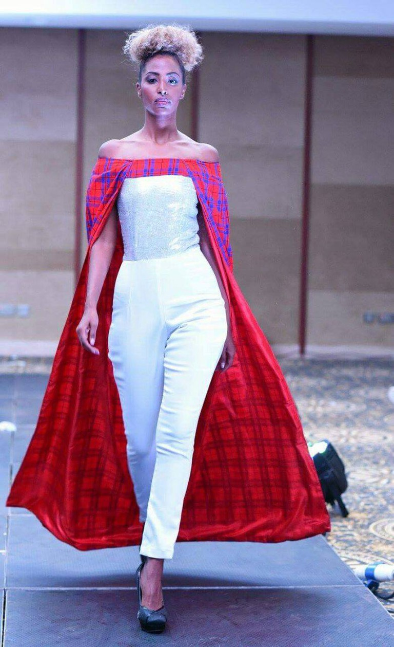 Jumpsuit and off-shoulder cape | Courtesy of Vivienne Taa