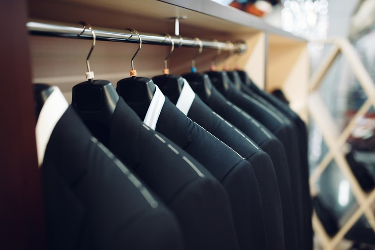 Rows of men's suit jackets| © Chumash Maxim/Shutterstock