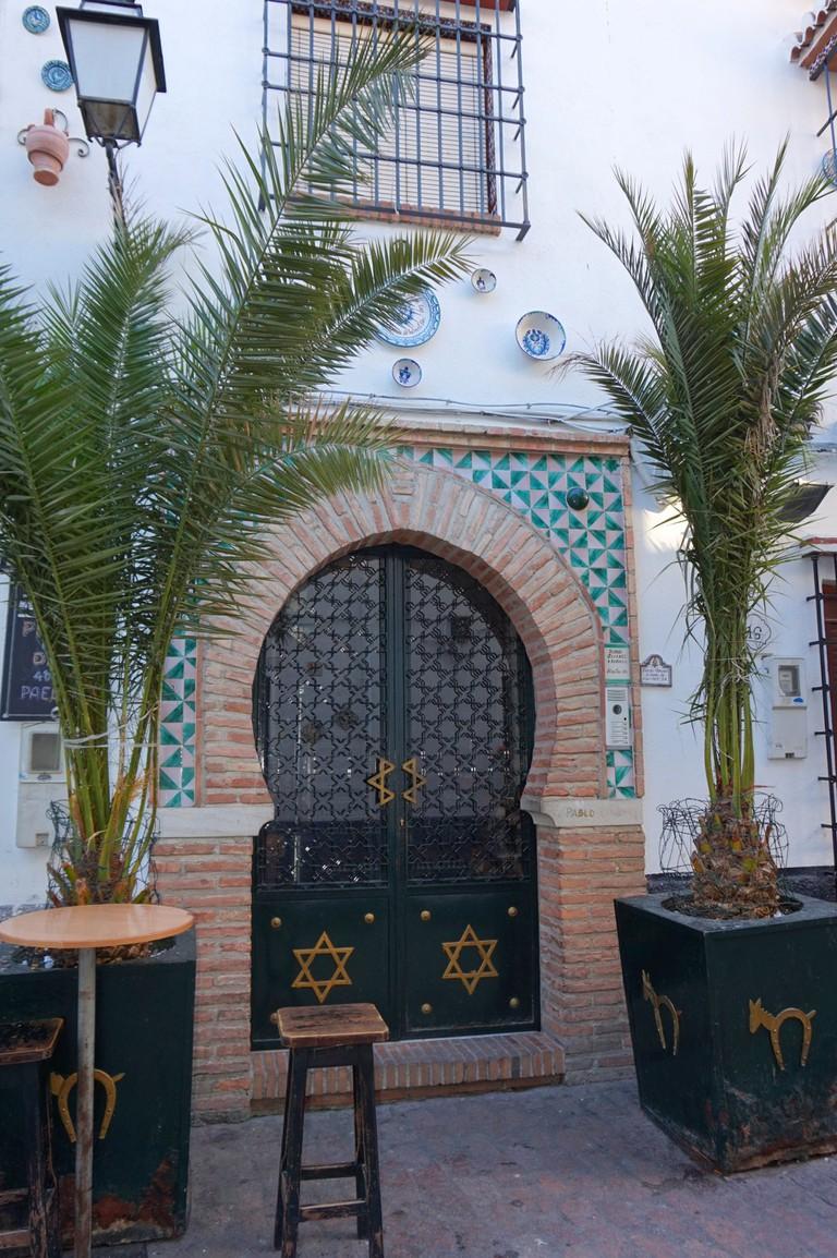 Moorish arched doorway in Albaicín, Granada, courtesy of Encarni Novillo