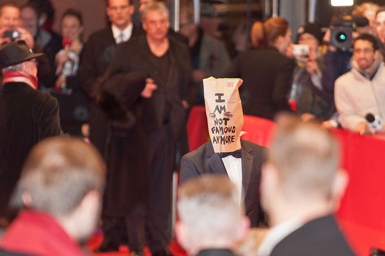 """Shia LaBeouf wearing a paper bag on his head at the premiere of the film """"Nymphomaniac (I) 