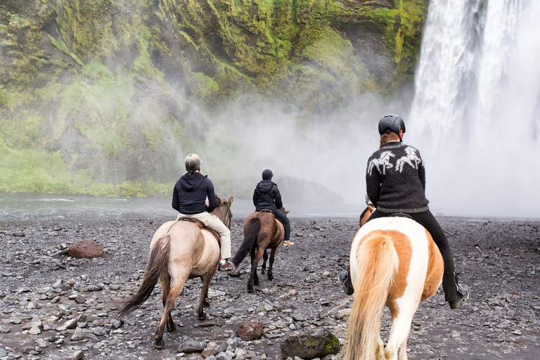 Horseback riding at Skogafoss Waterfall, Iceland | ©Anna Levan/Shutterstock