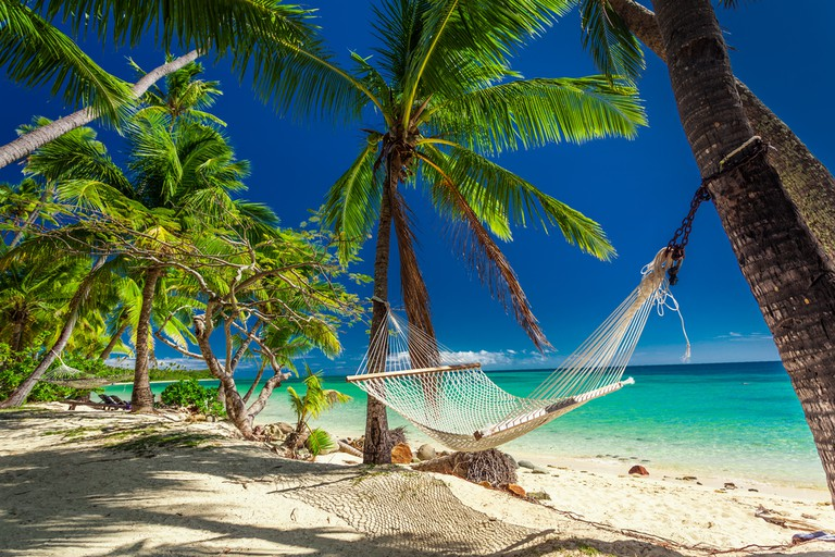 Beachfront hammock in the Fiji Islands | © Martin Valigursky