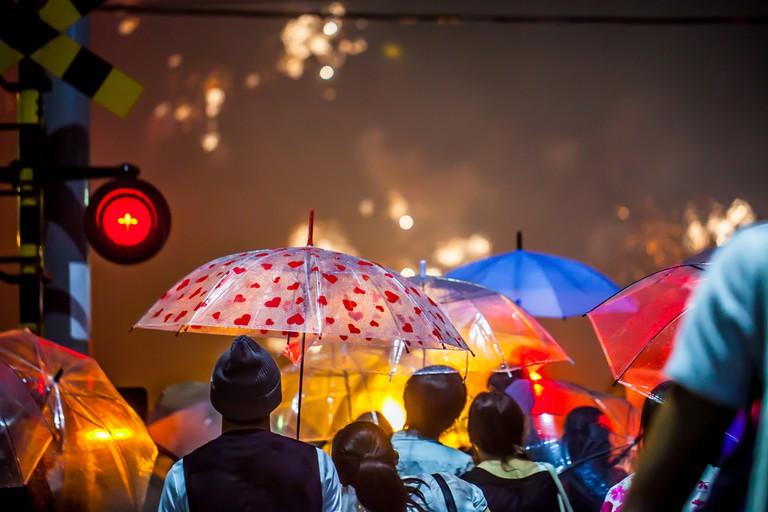 Enjoying fireworks festival Hanabi at lake Biwa in Otsu, Japan © umitomori.o / Shutterstock