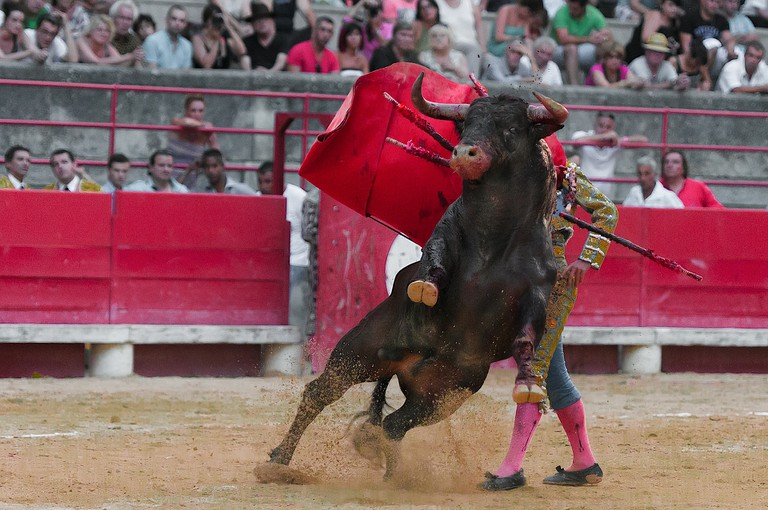 Bullfighting posters depict dramatic scenes from the spectactle they advertise; pixabay