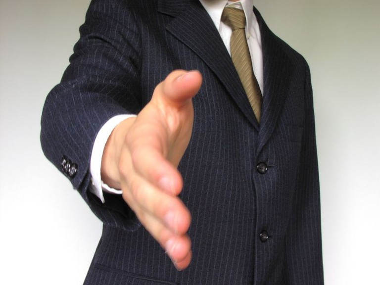 business-man-offering-hand-shake | © Johnny Magnusson/ Free Stock Photos