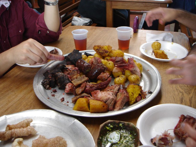 Colombians' enjoying a Fritanga Meal © Yassef Briceño Garcia