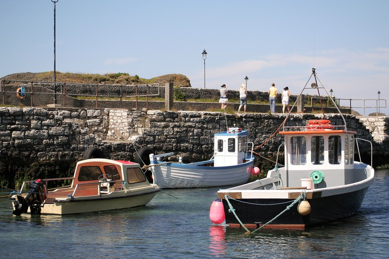 Boats along the peer, Ballintoy | © Grace Smith/ Flickr