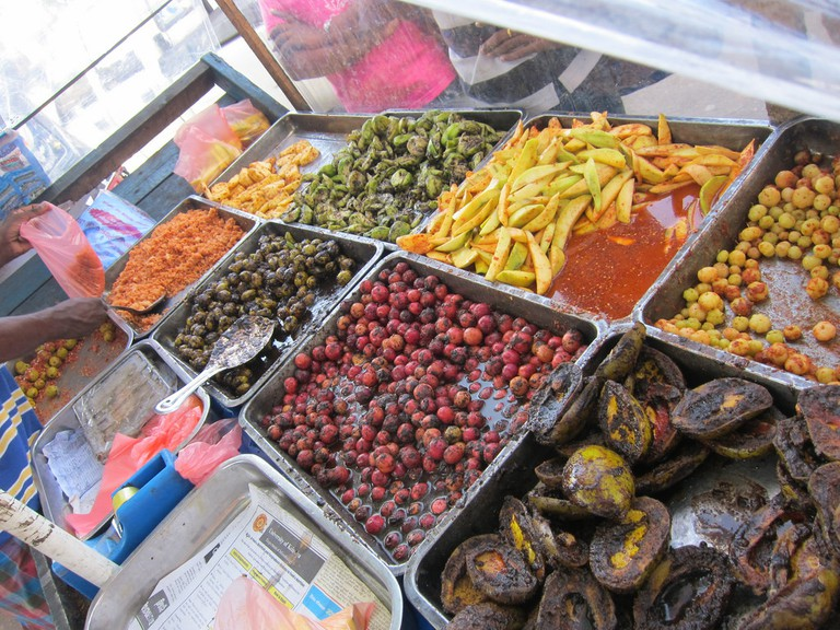 A roadside Achcharu Stand with all kinds of achcharu (pickled fruit). Most with chili - mango, pineapple and a whole bunch of local berries. | ©Indi Samarajiva - Flickr