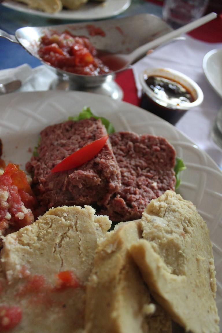 Fante Kenkey w/ Corned Beef and Chili Sauce
