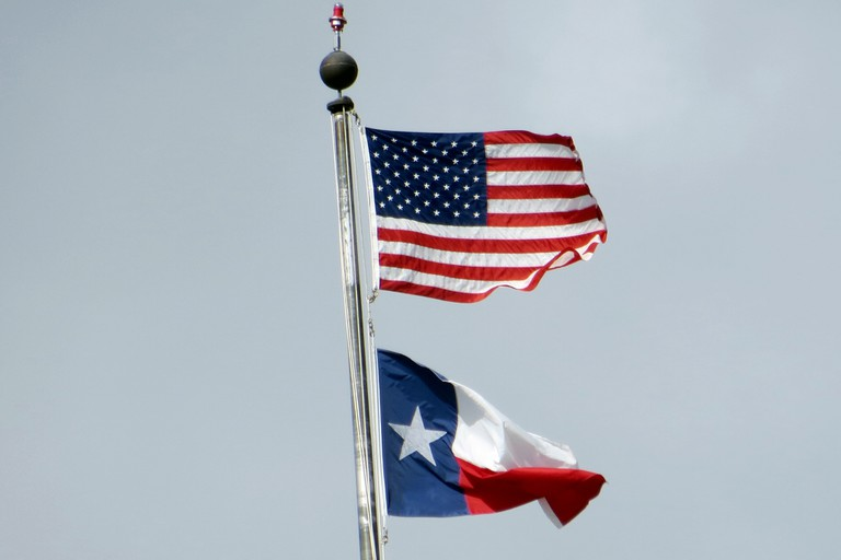 U.S. and Texas flags © Alan Kotok / Flickr