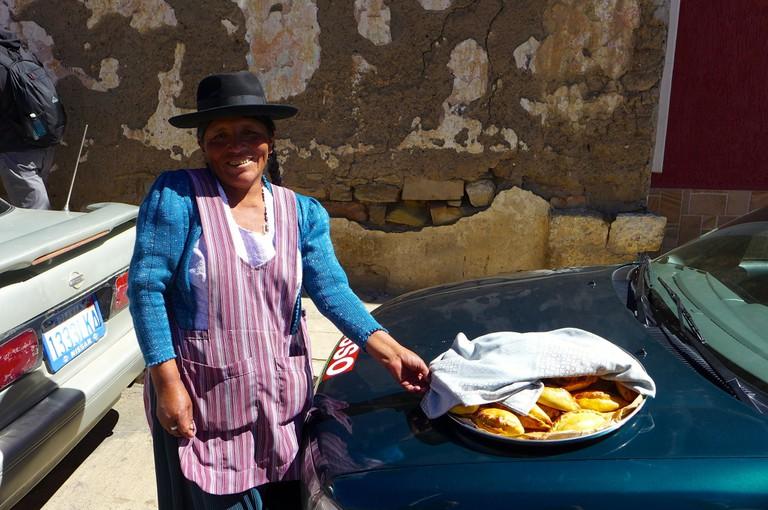 Woman selling salteñas | © Madeleine Deaton