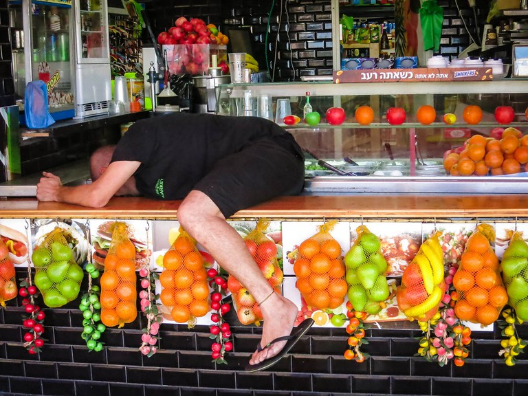 Juice stands are common in Tel Aviv, as is lazing around
