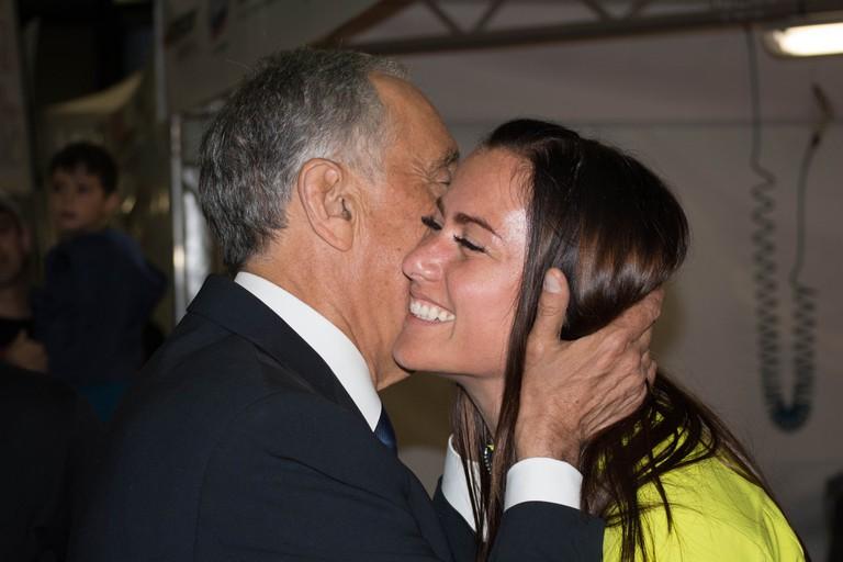 Kiss on cheek as a way to say hello or goodbye © harpagornis Wikimedia CC