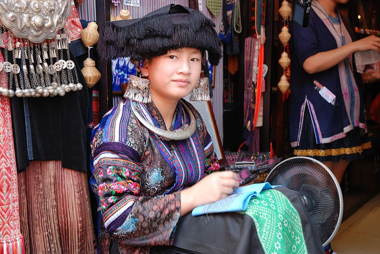 Young Miao woman in Yangshuo, China, wearing national costume|©Thomas Schoch/Wikimedia Commons