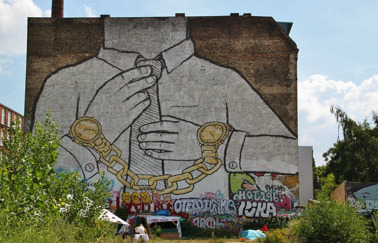 The mural by street artist Blu was removed by him and him crew in protest against development companies profiting off the artistic appeal of the city   © Pixabay