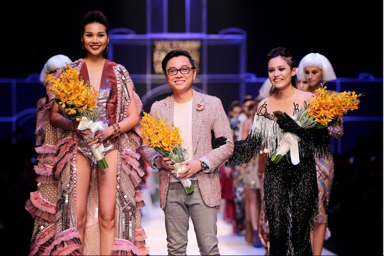 Vietnamese Designer Nguyen Cong Tri Poses with Models After the Presentation of His Collection During the Vietnam International Fashion Week | © Luong Thai Linh/Epa/REX/Shutterstock