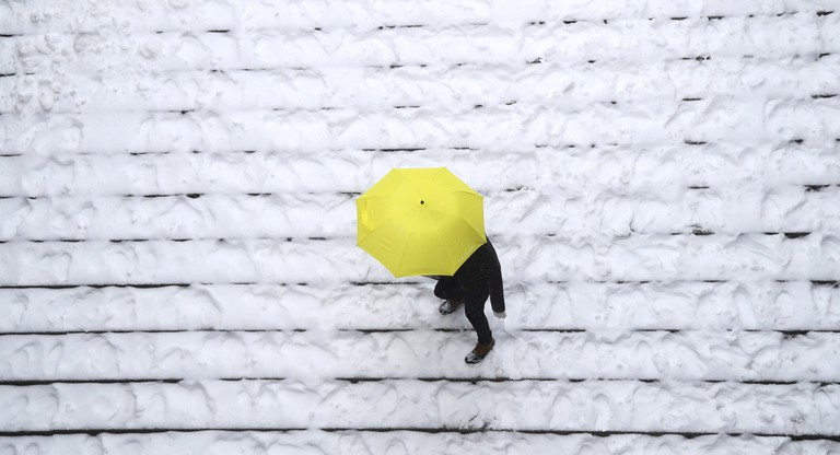 Mandatory Credit: Photo by ANDREW GOMBERT/EPA/REX/Shutterstock (8519891p) A person walks down stairs in the snow in Central Park as part of a major storm system moving into the Northeastern US that may bring as much as 24 inches (61 cm) of snow to some areas in New York, New York, USA, 14 March 2017. While New York City and Boston had been issued a blizzard warning, that has been downgraded to a winter storm as the storm's track shifted resulting in a shift to rain for both cities and smaller forecast snowfall totals. Late season snowstorm hits US Northeast, Brooklyn, USA - 14 Mar 2017