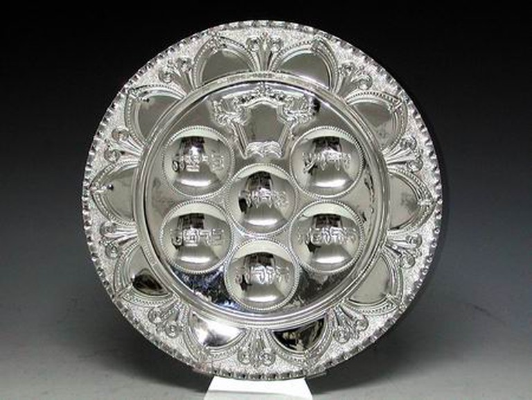 This silver Seder plate has different sections for items used during the Passover Seder | Hadad Brothers, Wikipedia, : https://en.wikipedia.org/wiki/Passover#/media/File:SederPlate.jpg