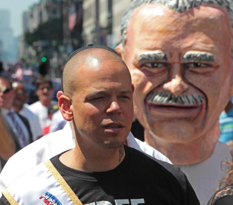 Musician Residente in front of Oscar Lopez Rivera cabezudo| © a katz/ Shutterstock