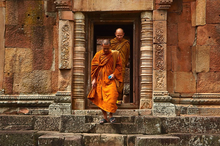 Monks coming out of a temple | Pexels