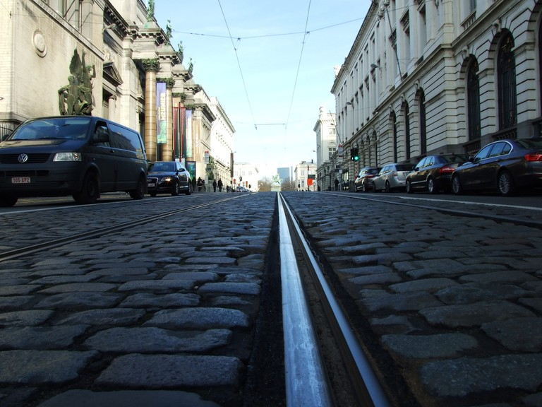 Tracks amidst the Brussels cobblestones | public domain